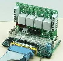 photo showing a DT205 relay board mounted on a DT004 mother board connected to a PC parallel port via ribbon cable